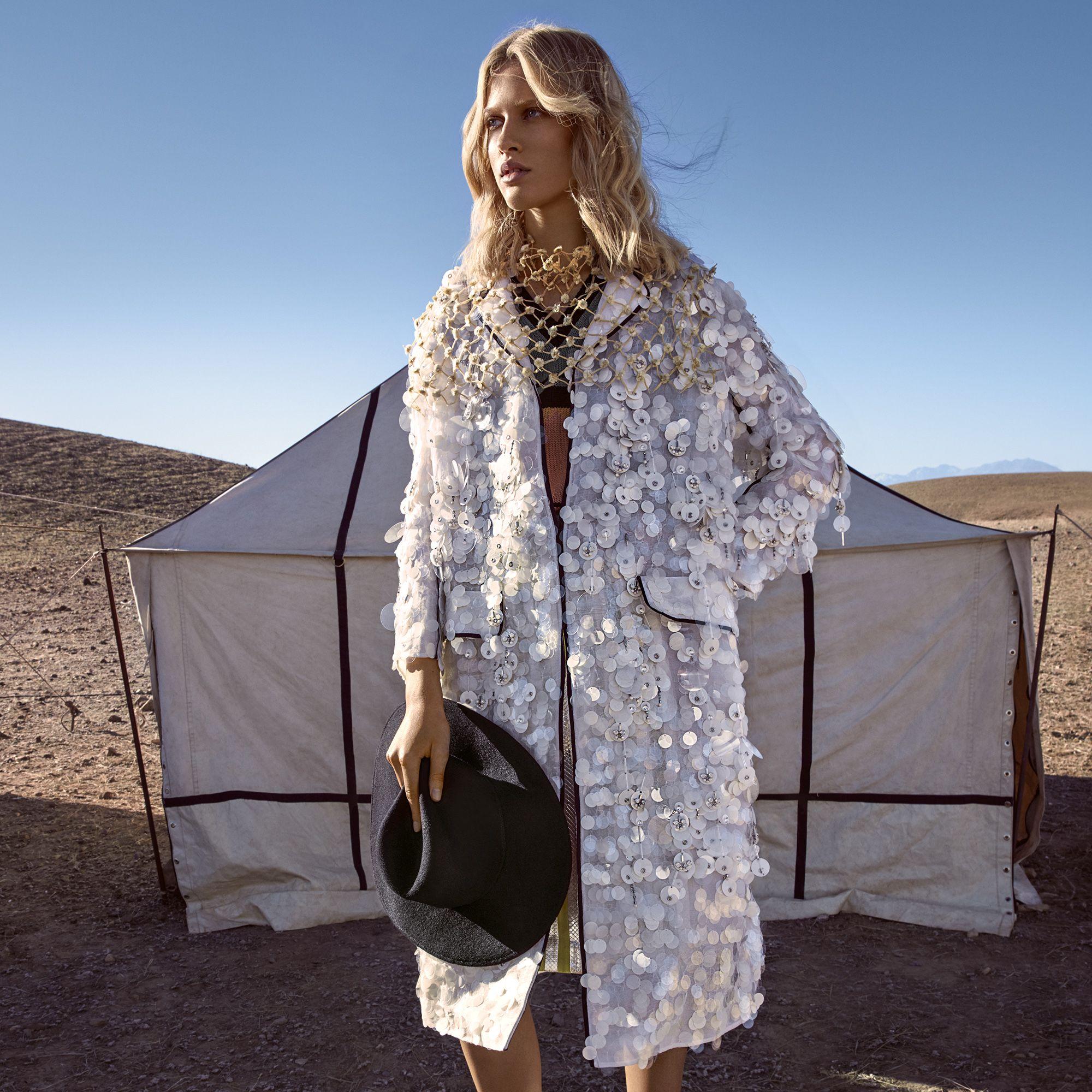 "<p><strong>Prada </strong>coat, $12,820, sweater-vest, $1,190, skirt, $5,280, and neckpiece, $525, <a href=""http://prada.com"" target=""_blank"">prada.com</a>&#x3B; <strong>Satya Twena </strong>hat (worn throughout), $425, <a href=""http://satyatweena.com"" target=""_blank"">satyatweena.com</a>&#x3B; <strong>Céline</strong> boots (worn throughout), $1,750, 212-420-7300. </p>"
