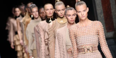 Fashion model, Fashion, Neck, Street fashion, Eyelash, Fashion show, Earrings, Model, Fashion design, Haute couture,