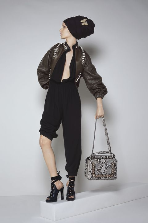 "<p><strong>Fendi</strong> jacket, price upon request, jumpsuit, $2,900, booties, $1,450, and bag, price upon request, 212-897-2244; <strong>Bucelatti </strong>brooch, price upon request, <a href=""http://bucelatti.com"" target=""_blank"">bucelatti.com</a>. </p>"