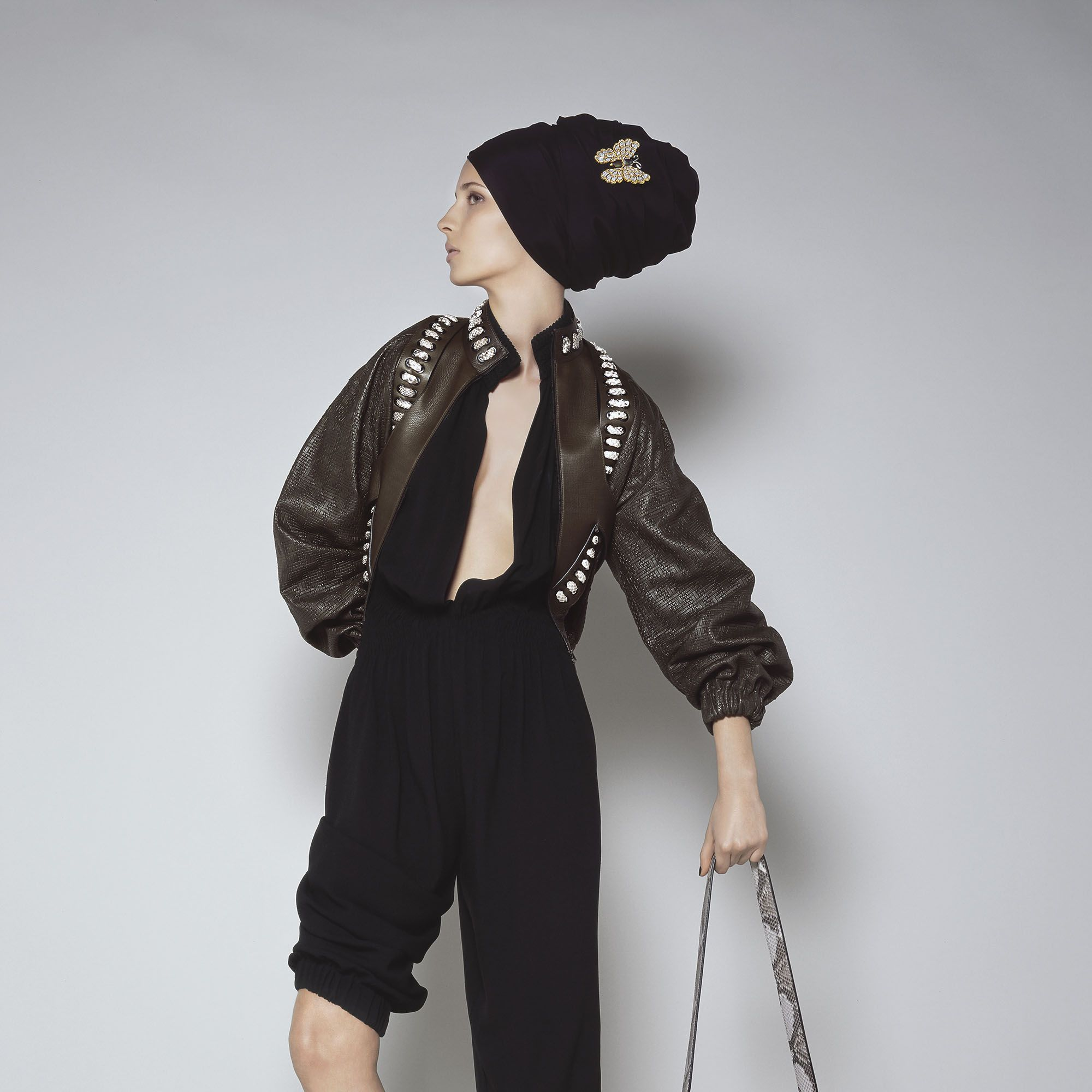 "<p><strong>Fendi</strong> jacket, price upon request, jumpsuit, $2,900, booties, $1,450, and bag, price upon request, 212-897-2244&#x3B; <strong>Bucelatti </strong>brooch, price upon request, <a href=""http://bucelatti.com"" target=""_blank"">bucelatti.com</a>. </p>"