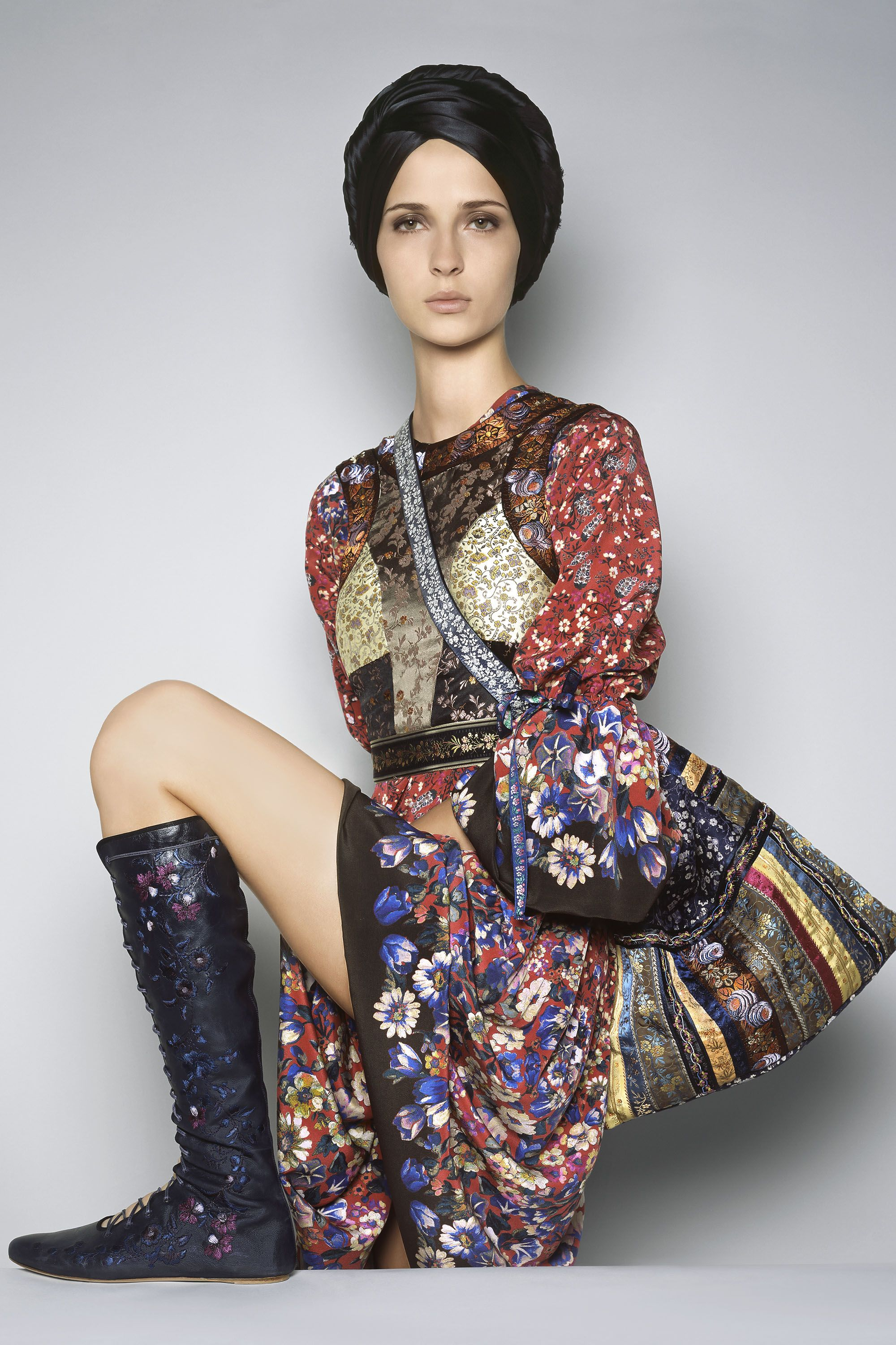 <p><strong>Etro</strong> vest, $1,623, dress, $2,756, bag $3,665, and boots, $2,646, 212-317-9096.</p>