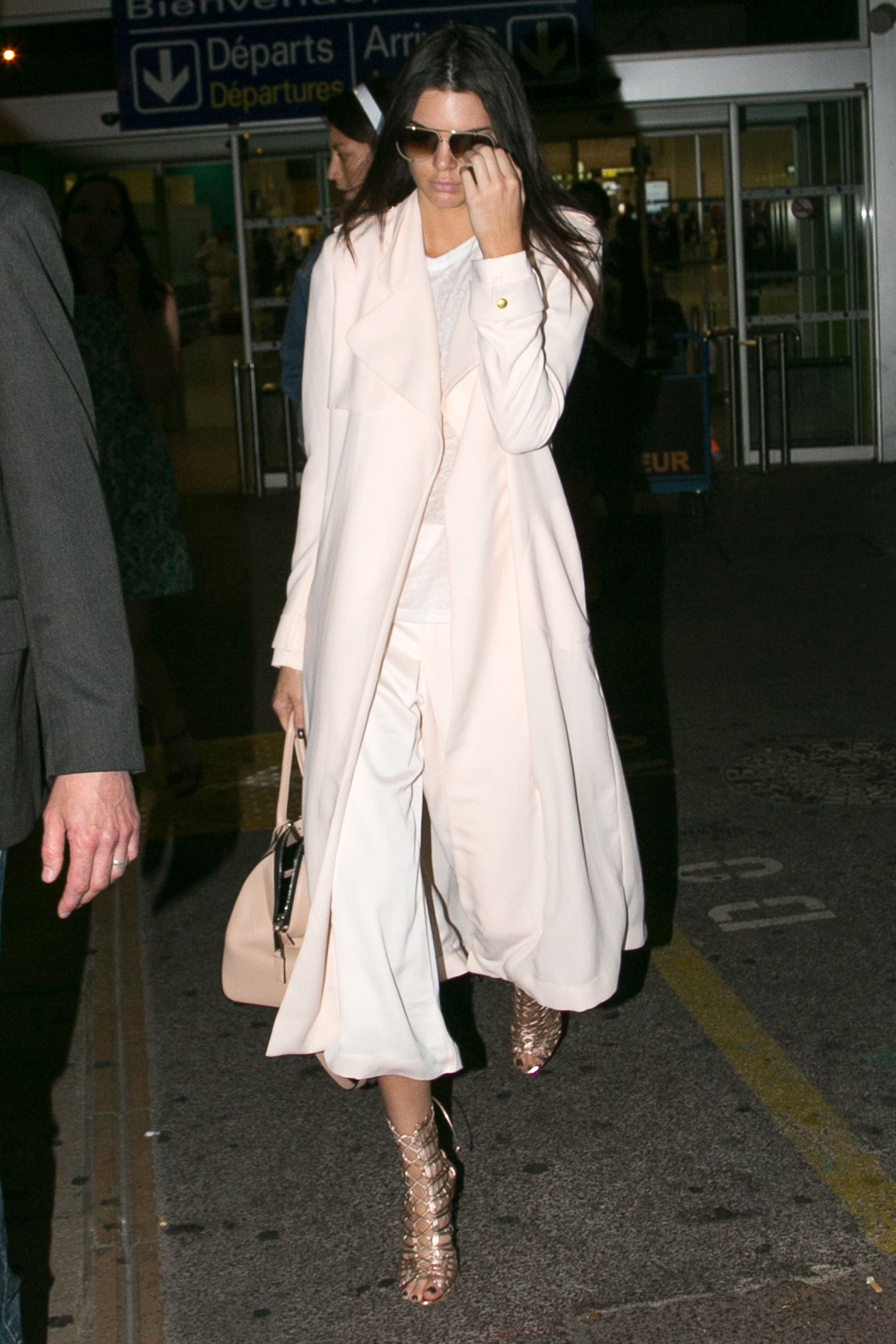 <p>Jenner goes monochromatic in ultra-flattering shades of cream.</p>