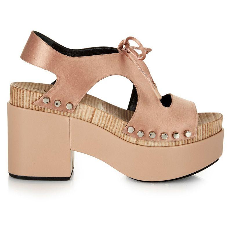 "<p><em>Balenciaga, $805, <a href=""http://www.matchesfashion.com/us/products/Balenciaga-Cut-out-satin-platform-sandals-1036567"" target=""_blank"">matchesfashion.com</a>.</em></p>"