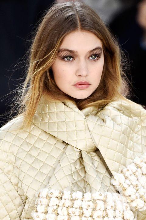 Lip, Hairstyle, Skin, Sleeve, Collar, Textile, Eyelash, Style, Fashion model, Beauty,