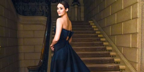Clothing, Hairstyle, Shoulder, Dress, Strapless dress, Stairs, Beauty, Fashion, Black, Gown,
