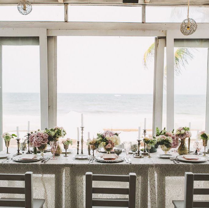"""<p><a href=""""https://www.venuereport.com/venue/casa-violeta/"""" target=""""_blank"""">This dreamy bohemian beach venue</a> gives """"Vamos a la Playa"""" a whole new meaning. Bordered by the white sand beaches of Tulum, this hotel merges Caribbean style eats, daily yoga and a healing spa for a wedding weekend filled with relaxation. The stark white aesthetic and elegant table spreads makes for an opulent desert-island feel that you'll never want to escape from. </p>"""