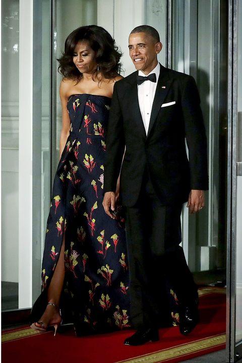 Clothing, Coat, Dress, Trousers, Shoulder, Shirt, Suit, Standing, Outerwear, Formal wear,