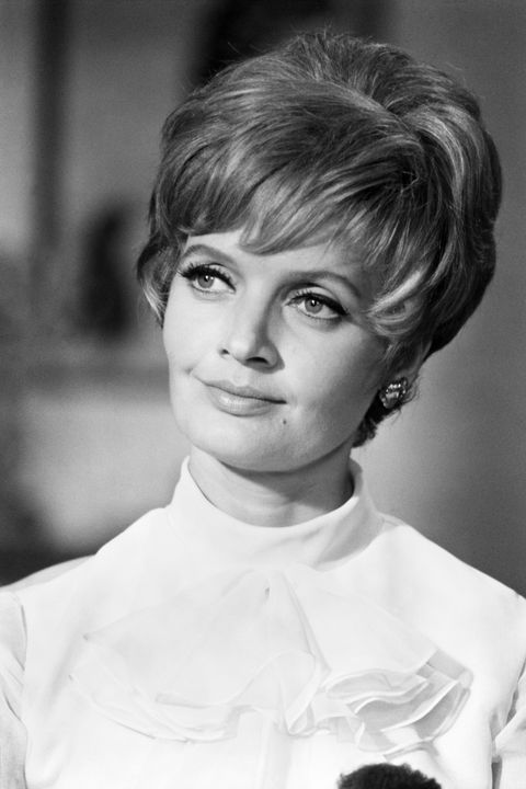 <p>A matriarch of six needs a no-nonsense hairstyle, like the teased, feathered pixie worn by Florence Henderson. </p>