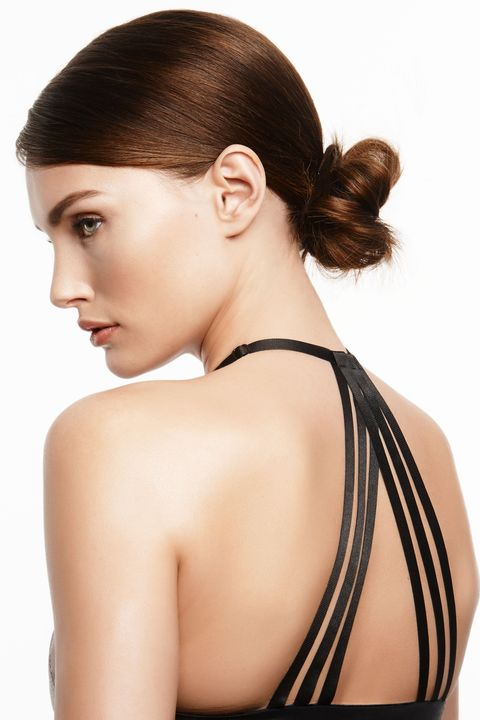 "<p>A low, not-so-perfect bun is a workout staple. But by creating a deep side part instead of slicking hair straight back, the effect is far more flattering for every face shape. ""It keeps some hair surrounding your face for a softer effect,"" says Vigi. After styling, spray <a href=""http://bit.ly/1XxGAP4"" target=""_blank"">Nexxus New York Salon Care Frizz Defy Finishing Mist</a> to keep hair in place from barre class to brunch.</p><p><br></p><p><em><strong>Splits59</strong> London Performance Support Tank, $82, </em><a href=""https://www.splits59.com/london-performance-support-tank-bras-bra-tops-p-925-c-18_25.html"" target=""_blank""><em>splits59.com</em></a></p>"