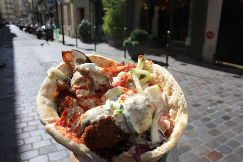 "<p>Situated in the heart of Paris' Jewish Quarter on Rue de Rosiers, L'As du Fallafel houses some of the best falafel you'll ever eat outside of Israel. Don't be deterred by the long line out front and resist the temptation to choose one of the many imitation falafel joints on this street with a shorter line as an alternative. Here, the long line is undoubtedly worth the wait. Top your crispy concoction with roasted eggplant, creamy tahini,<span class=""redactor-invisible-space""> an array of hot sauces (and even top with pommes frites if you're feeling indulgent!) for the perfect medley of mouth-watering flavors. We're not sure if you'll have room for dessert, but if you do, head down the block to <a href=""http://finkelsztajn.com/"" target=""_blank"">Sacha Finkelsztajn: La Boutique Jaune</a> for a Jewish pastry (they may just be the best homemade rugelach you'll ever taste.) Hint: for both of these eats, extra napkins are a must.</span></p><p><em><a href=""http://www.yelp.com/biz/l-as-du-fallafel-paris"" target=""_blank"">L'As du Fallafel</a><span class=""redactor-invisible-space"" style=""line-height: 1.6em&#x3B; background-color: initial&#x3B;""><a href=""http://www.yelp.com/biz/l-as-du-fallafel-paris""></a>, </span></em><em>Rue des Rosiers, 75004 Paris</em></p><p><em><a href=""http://finkelsztajn.com/"" target=""_blank"">Sacha Finkelsztajn: La Boutique Jaune</a>, Rue des Rosiers, 75004 Paris<br></em></p>"