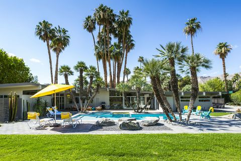 "<p>This <a href=""http://www.luxuryretreats.com/North-America/United-States/California-Desert-Cities/Palm-Springs/Sanctuary-113076"" target=""_blank"">three-bedroom property</a> in Rancho Mirage dates back to the 1960's and was originally designed by famed architect Donald Wexler. The home has been slowly and carefully modernized over time to include a firepit and some much needed air conditioning, but it's original fireplace and mid-century décor still remain, complete with an Eames lounger and Jeff Koons sculpture. This address is ideal for a couples share, with queen beds in every room, a large poolside and outdoor dining area and access to the area's famous golf courses for guys and girls days out. For an extra fee,  a daily chef, housekeeper, butler, babysitting service and at-home spa services can be provided.  <em>From $995 per night</em>. <span class=""redactor-invisible-space""></span></p>"