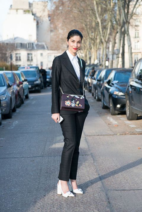 "<p>""You can never go wrong with a well-tailored suit! During fashion month, I usually bring a tuxedo as my go-to evening outfit. Pair with great heels, jewelry and lipstick and you're as chic as can be. I like <a href=""http://shop.nordstrom.com/s/4198189?&cm_mmc=Mindshare_Nordstrom-_-0411carolinaissa-_-Hearst-_-proactive"" target=""_blank"">jackets</a> that are slightly nipped-in at the waist for a feminine silhouette, but aren't <em>too</em> fitted so they retain that masculine flavor. Suiting is all about the details— how the jacket closes, the cut in the back, and the silhouette of the <a href=""http://shop.nordstrom.com/s/4189939?&cm_mmc=Mindshare_Nordstrom-_-0411carolinaissa-_-Hearst-_-proactive"" target=""_blank"">trousers</a>.""</p><p><strong><br></strong></p><p><strong>SHOP HER LOOK:</strong></p><p><a href=""http://shop.nordstrom.com/s/4192201?cm_mmc=Mindshare_Nordstrom-_-0411carolinaissa-_-hearst-_-proactive"" target=""_blank"">Givenchy 'Mini Pandora Box' Leather Shoulder Bag</a></p><p><br></p><p><a href=""http://shop.nordstrom.com/s/4179758?cm_mmc=Mindshare_Nordstrom-_-0411carolinaissa-_-hearst-_-proactive"" target=""_blank"">Givenchy Pointy Toe Mule</a></p><p><br></p>"