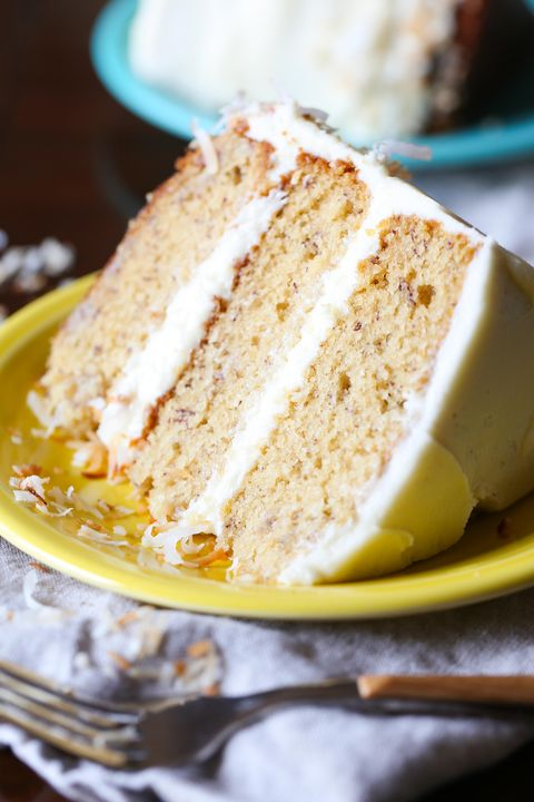 "<p><a href=""http://cookiesandcups.com/best-banana-cake/ "" target=""_blank"">Best Banana Cake</a> </p><p>By Shelly Jaronski of <a href=""http://cookiesandcups.com/"" target=""_blank"">Cookies & Cups</a> </p><p><strong>Ingredients: </strong><br> </p><p><em>Cake</em> </p><ul> <li>1½ cups milk</li> <li>2 tablespoons lemon juice</li> <li>¾ cup butter, room temp</li> <li>1 cup light brown sugar</li> <li>1 cup granulated sugar</li> <li>3 eggs</li> <li>1 tablespoon vanilla extract</li> <li>1 teaspoon kosher salt</li> <li>1½ teaspoons baking soda</li> <li>3 cups flour</li> <li>3 ripe medium bananas mashed, approximately 1½ cups</li> </ul><p><em>Frosting</em> </p><ul> <li>8 ounces cream cheese, room temperature</li> <li>1 cup butter, room temperature</li> <li>6 cups powdered sugar</li> <li>1 teaspoon vanilla extract</li> <li>1-2 tablespoons milk</li> <li>optional - ¾ cup sweetened flaked coconut</li> </ul><p><strong>Directions:</strong><span class=""redactor-invisible-space""><br></span> </p><p>Preheat oven to 325°F</p><p>Coat 3, 8-inch round cake pans or 2 9-inch round cake pans with nonstick spray. Cut parchment paper into rounds to fit into the bottoms of the pans. Place the parchment into each pan and coat again with nonstick spray. Set aside.</p><p>In a medium bowl combine the milk and lemon juice. Stir and set aside.</p><p>In the bowl of your stand mixer fitted with the paddle attachment beat the butter and both sugars on medium speed for 2 minutes.</p><p>Add in the eggs, vanilla, salt and baking soda and mix until smooth, scraping the sides of the bowl as necessary.</p><p>Turn the mixer to low and add in the flour and milk in alternating additions, beginning and ending with flour, scraping the sides of the bowl as necessary.</p><p>Finally mix in the bananas until just incorporated.</p><p>Divide the batter evenly among the pans and bake for 35 minutes or until a toothpick inserted in the center comes out clean, rotating the pans in the oven half-way through baking.</p><p>Allow the cakes to cool in the pans for 15-20 minutes and then remove from the pans and place on a wire rack to cool completely.</p><p><em>Frosting:</em></p><p>In the bowl of your stand mixer fitted with the paddle attachment mix the butter and cream cheese together for 2 minutes until creamy. Turn mixer to low and add in the powdered sugar.</p><p>Finally add in the vanilla and 1 tablespoon of milk.</p><p>Turn the mixer up to medium and mix until creamy, scraping the sides of the bowl as necessary.</p><p>If desired add in the remaining tablespoon of milk and mix until combined.</p><p>Frost cake.</p><p>If desired place the coconut in a nonstick skillet. Heat over medium-low, stirring frequently. The coconut will begin to turn golden brown. Watch closely, as the coconut will burn quickly.</p><p>Remove the pan from the heat and allow the coconut to cool completely.</p><p>Garnish cake with the toasted coconut.</p>"