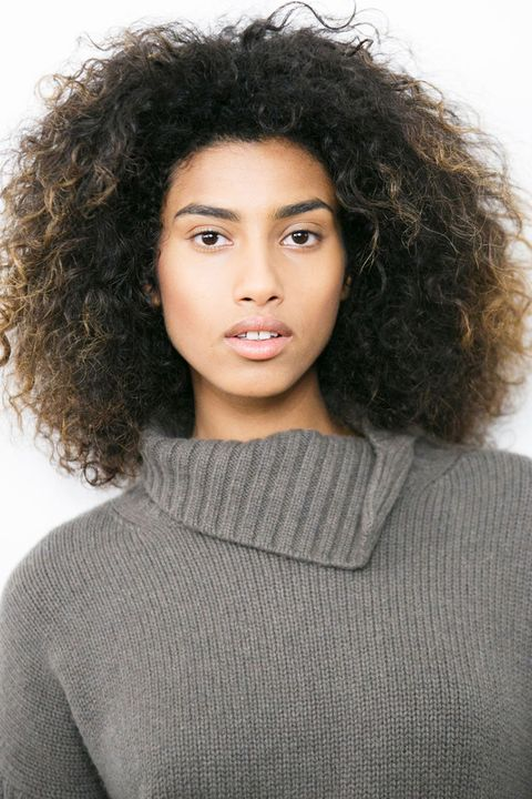 Lip, Hairstyle, Sleeve, Chin, Forehead, Shoulder, Eyebrow, Sweater, Style, Jheri curl,