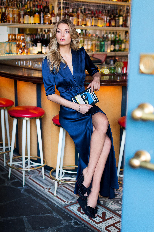 <p><strong>What do you buy in bulk?</strong> I've been through a fair amount of Converse and leather pants, that's for sure.<br></p><p><strong>Favorite fashion movie?<em> </em></strong><em>Clueless</em>.</p><p><em>Luisa Beccaria blue dress; </em><em>Olympia le tan clutch; B</em><em>ulliony gold necklace; </em><em>Charlotte Olympia shoes; V</em><em>enyx ring. </em></p>