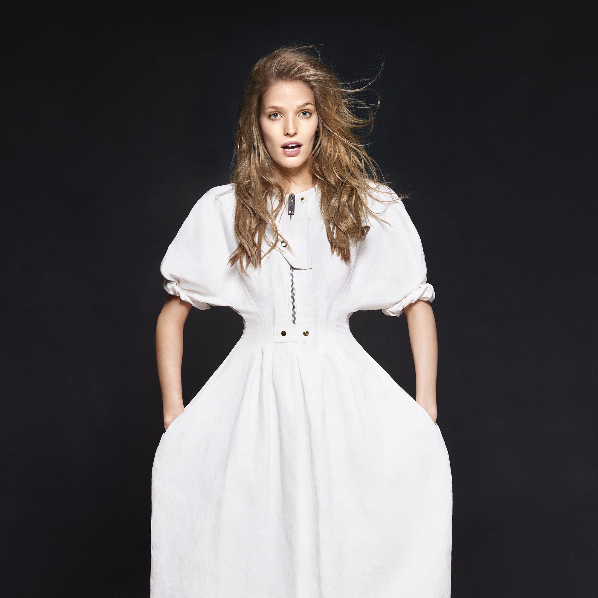 <p>A crisp sculpted dress flatters every figure.</p><p><strong>Céline </strong>dress, $2,600, earrings, $1,050, and boots, $1,750, 212-420-7300. </p>