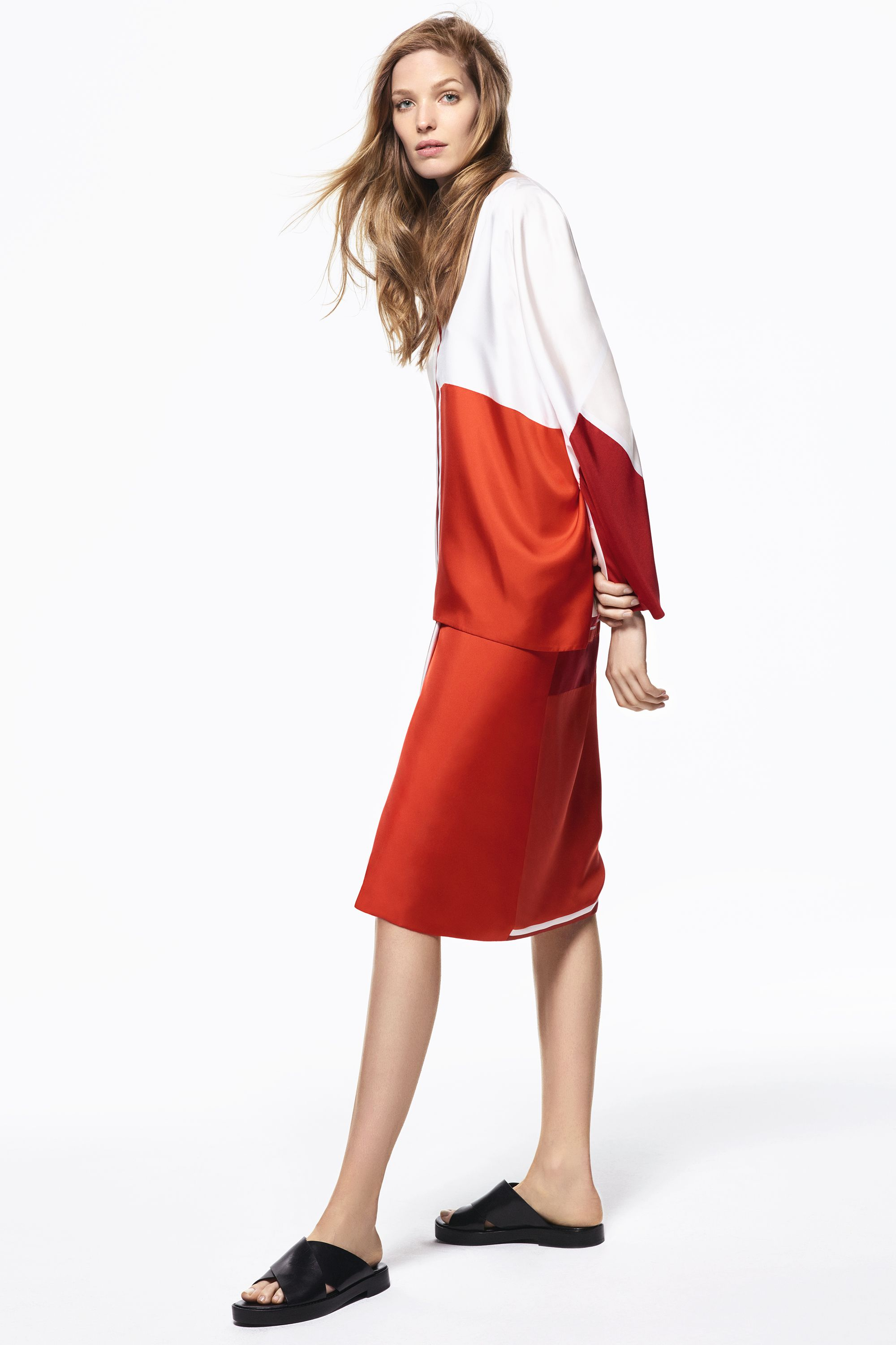 "<p>Play up silky separates by choosing ones in poppy hues.</p><p><strong>Hermès </strong>blouse and skirt, prices upon request, 800-441-4488; <strong>Michael Kors </strong><span class=""redactor-invisible-space""><strong>Collection </strong><span class=""redactor-invisible-space"">sandals, $425, 866-709-KORS.</span></span></p>"