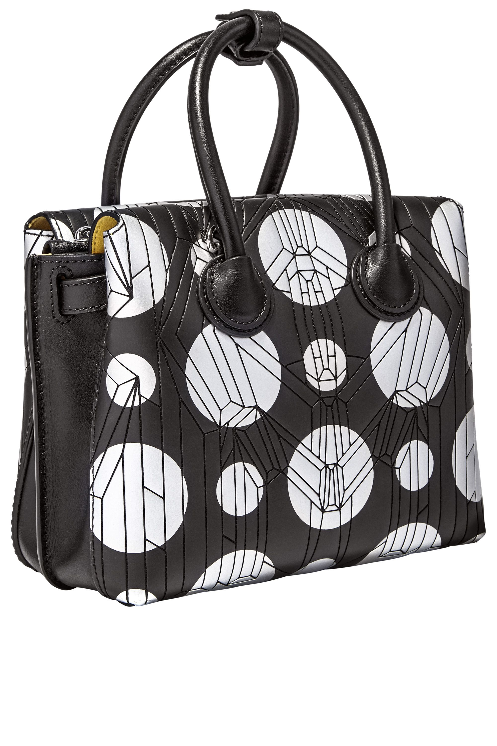 "<p><strong>MCM </strong>tote, $720, <a href=""http://www.mcmworldwide.com/"">mcmworldwide.com</a>.</p>"