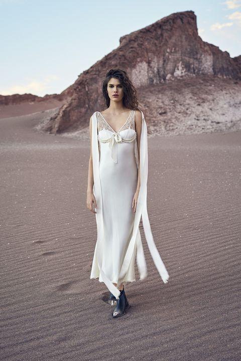<p><strong>Balenciaga</strong> dress, $6,300, 212-206-0872; <strong>Louis Vuitton</strong> boots, price upon request, 866-VUITTON.</p>