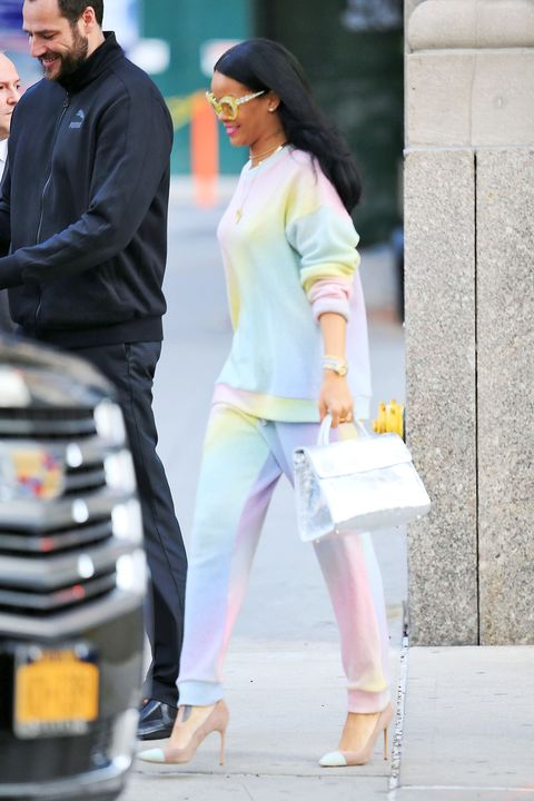 5d22a52e0 Rihanna accessorized her bright ensemble with a metallic Diorever bag.