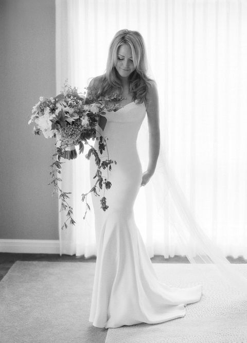 "<p>The bride's gown was custom made for her by family friend, <a href=""http://www.narcisorodriguez.com/"" target=""_blank"">Narciso Rodriguez</a>. ""Narciso was a dear friend of my mothers, and for that reason I knew him from a young age–I actually modeled in one of his shows when I was 17!"" The bride's late mother was a founder and co-owner of <a href=""http://www.fortyfiveten.com/"" target=""_blank"">Forty Five Ten</a> in Dallas, TX and a fashion fixture in both Dallas and the industry as a whole. ""After my mom passed away, so many of her fashion friends reached out and were so loving and supportive, and Narciso was one of them. I think him making my gown was just one more way for him to express his love both for me and for my mother."" The bride accessorized her minimalistic sheath with a veil by Rodriguez, flat Prada sandals for her outdoor ceremony and <a href=""http://www.kimberlymcdonald.com/"" target=""_blank"">Kimberly McDonald</a> jewels. Meredith carried a lush bouquet of white clematis, gardenia foliage, hops, peonies, eucalyptus anemones, freesia and maiden hair fern by <a href=""http://www.mindyrice.com/"" target=""_blank"">Mindy Rice</a>.</p>"