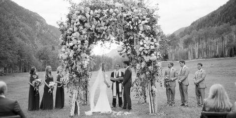 Petal, Photograph, Suit, Dress, Bridal clothing, Coat, Bride, Formal wear, Ceremony, Veil,