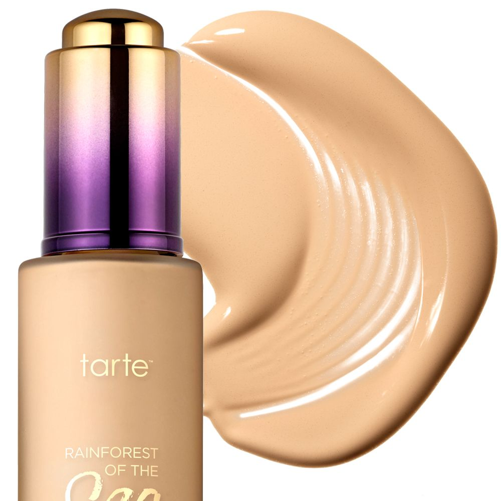 """<p><strong>FLAWLESS MAKEUP: </strong>Apply a hydrating foundation with a brush for a streak-free finish. Dust shimmery gold highlighter powder on cheeks, forehead, nose, and chin. For a subtle smoky eye, trace a soft black pencil along your waterlines, then sweep on a velvety-brown eye shadow. Finish with a lengthening mascara and a pretty pink lip.</p><p><strong>Tarte</strong> Rainforest of the Sea Water Foundation Broad Spectrum SPF 15, $39, <a href=""""http://www.sephora.com/"""" target=""""_blank"""">sephora.com</a>.<br></p>"""
