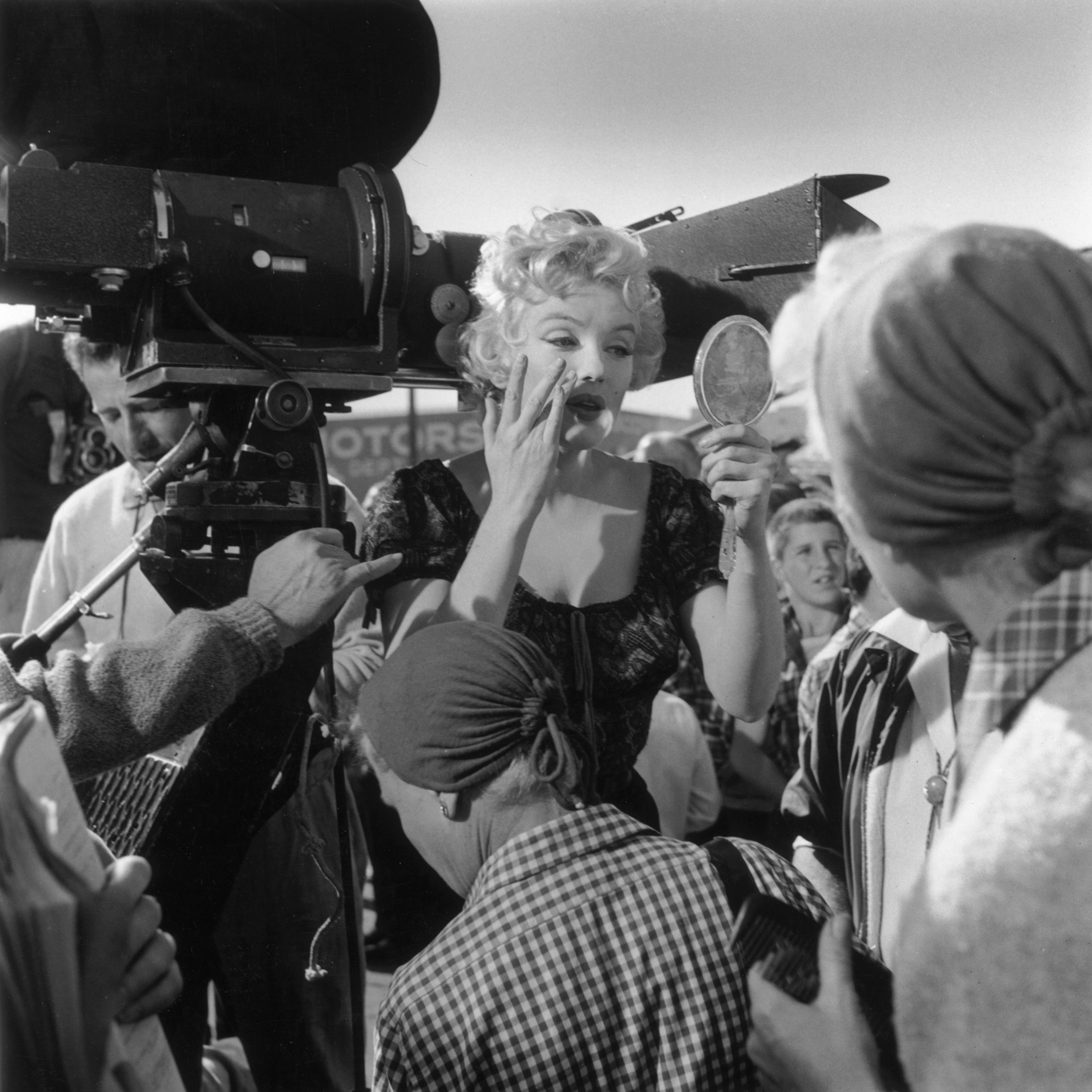 <p>Fixing her makeup on the set of <em>Bus Stop</em> in 1956</p>