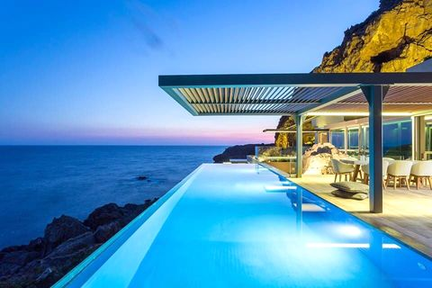 Blue, Coastal and oceanic landforms, Fluid, Real estate, Resort, Swimming pool, Ocean, Horizon, Sea, Outdoor furniture,
