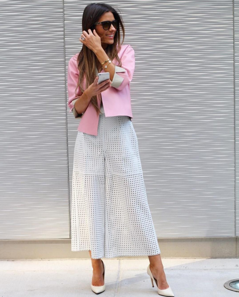 "<p>Modernize your suiting in airy culottes and a jacket that pops. For day-to-night, the blazer pulls your look together for the office, then take it off to reveal a cami or crop top for summer evenings out. <a href=""https://www.instagram.com/brookecarriehil/"">@brookecarriehil</a> wearing <em>ESCADA</em></p>"