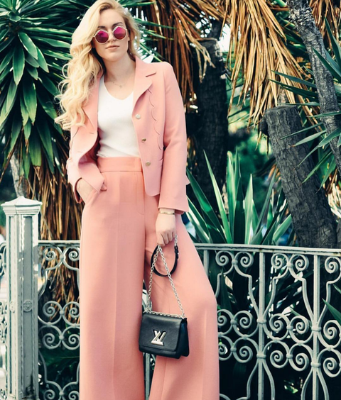 "<p>When you're heading to the office this summer, don't shy away from color. Reach for feminine suiting in a soft shade of pink—<i>the</i> color of the season. Keep your look tailored by opting for a pair of high-waisted pants and blazer, styled with a simple T-shirt and minimal accessories. <a href=""https://www.instagram.com/societygrl/"">@societygrl</a> wearing <em>ESCADA Toul Pants, $1,075, <a href=""http://bit.ly/1rhMwC1"">us.escada.com</a></em><br></p><p><em></em></p>"