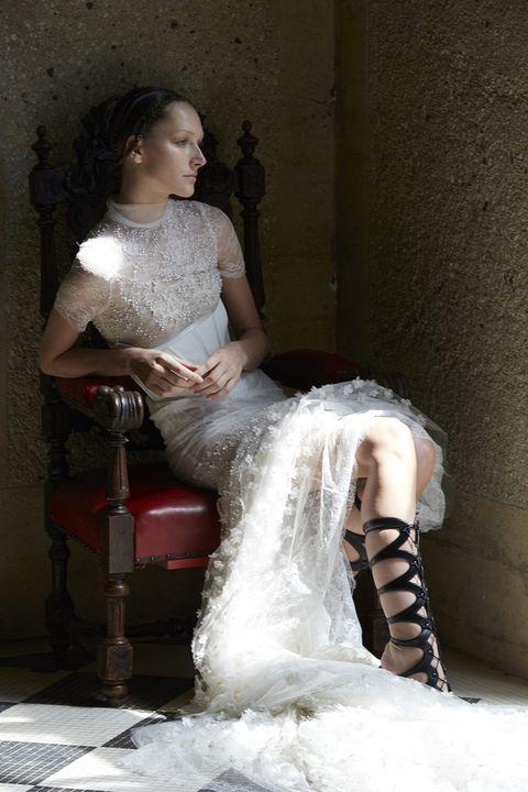Human body, Shoulder, Joint, Sitting, Dress, Beauty, Bridal clothing, Fashion, Waist, Flash photography,