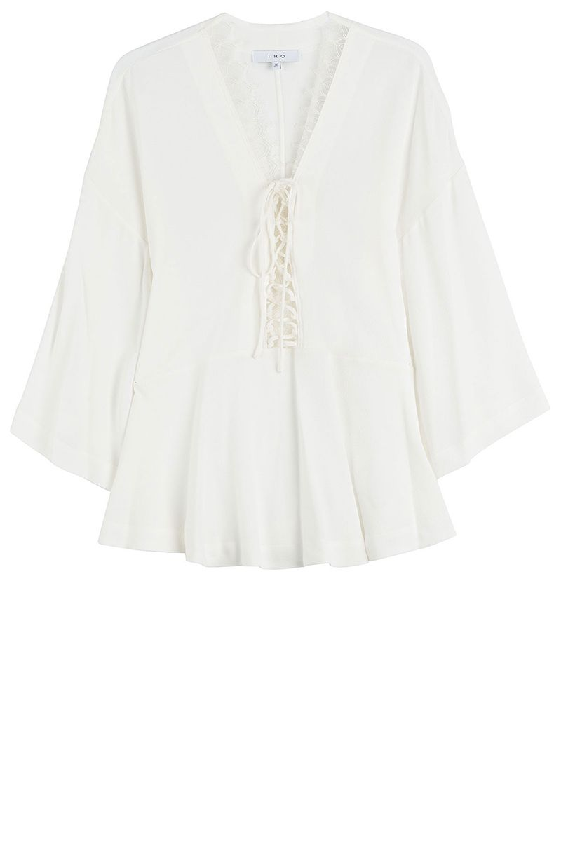 "<p>IRO top, $325, <a href=""https://www.iroparis.com/gl_en/emilda-18021.html"" target=""_blank"">iroparis.com</a>.</p>"