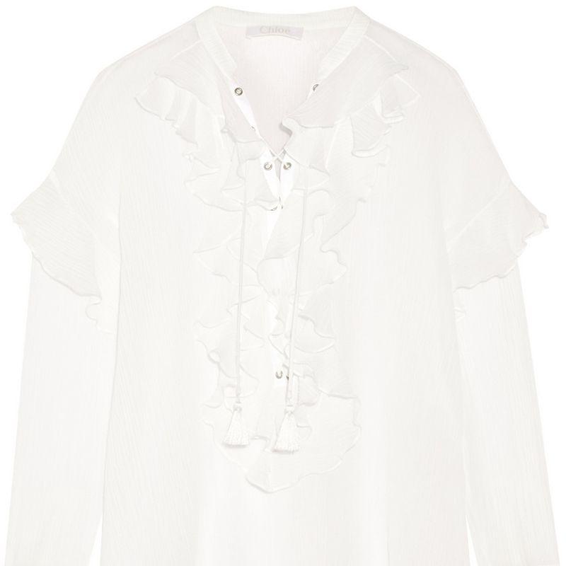 "<p><strong>Chloe</strong> top, $1,495, <a href=""https://www.net-a-porter.com/product/650794/Chloe/ruffled-lace-up-cotton-gauze-blouse"" target=""_blank"">shopBAZAAR.com</a>.</p>"
