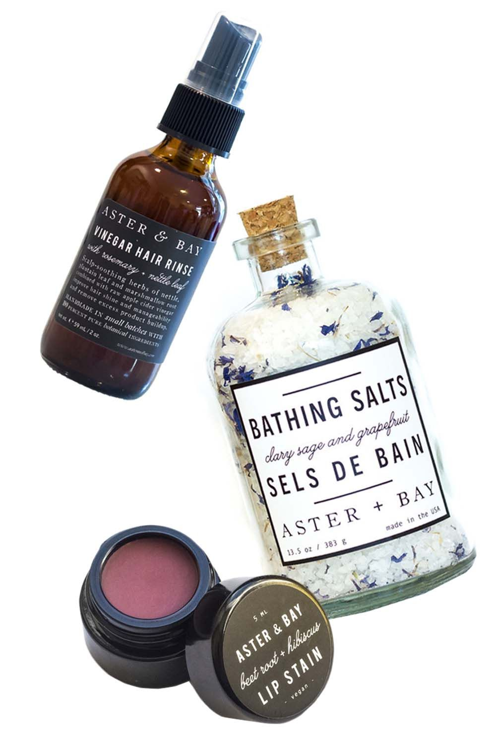 "<p>Inspired by Scottish craft preservation methods, herbal alchemy and plant folklore, this mom-and-pop brand out of Atlanta offers chemical- and- preservative-free products that come in beautiful recycled glass bottles. </p><p><strong>Aster + Bay</strong> Vinegar <a href=""http://asterandbay.com/products/vinegar-hair-rinse-rosemary-nettle"" target=""_blank"">Hair Rinse</a>, $18; Clary Sage + Grapefruit <a href=""http://asterandbay.com/products/bathing-salt-clary-sage-grapefruit"" target=""_blank"">Bathing Salts</a>, $32; and Beet Root + Hibiscus <a href=""http://asterandbay.com/products/lip-stain-beet-root-hibiscus"" target=""_blank"">Lip Stain</a>, $10, <a href=""http://asterandbay.com/"" target=""_blank"">asterandbay.com</a>.  </p>"