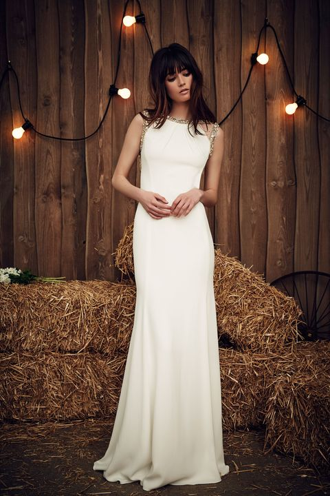 Lighting, Dress, Formal wear, Gown, Bridal clothing, Wedding dress, One-piece garment, Light fixture, Bride, Waist,