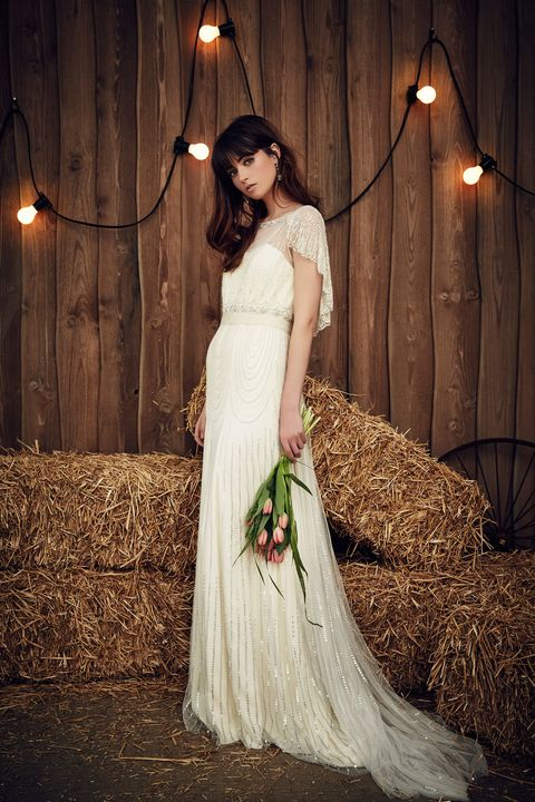 Clothing, Lighting, Hairstyle, Dress, Bridal clothing, Textile, Gown, Light fixture, Formal wear, Wedding dress,