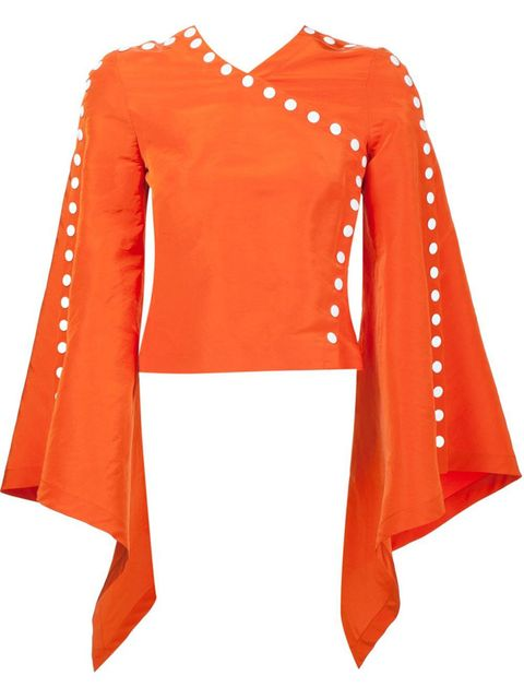 "<p><em>Rosie Assoulin top, $2,995</em><em>, <a href=""http://www.farfetch.com/shopping/women/rosie-assoulin-bell-sleeve-cropped-blouse-item-11431814.aspx?storeid=9662&from=1&ffref=lp_pic_11_2_"" target=""_blank"">farfetch.com</a>. </em></p>"