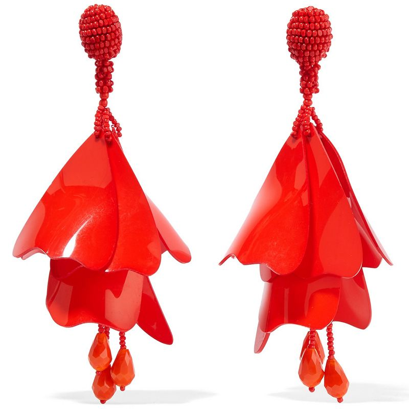 "<p><em>Oscar de la Renta earrings, $425, <a href=""https://www.net-a-porter.com/us/en/product/715767/oscar_de_la_renta/impatiens-gold-plated-resin-clip-earrings"" target=""_blank"">net-a-porter.com</a>.</em></p>"