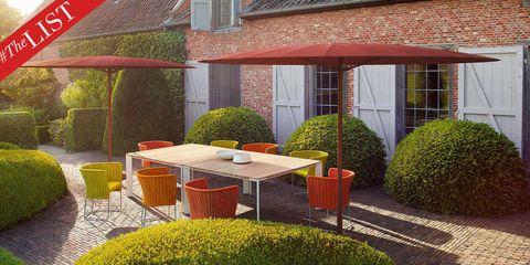 Plant, Window, Furniture, Shrub, Table, House, Outdoor table, Real estate, Garden, Outdoor furniture,