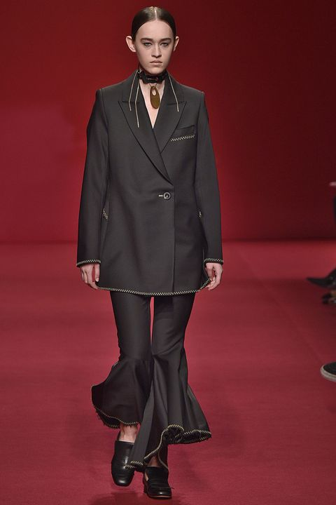 """<p><a href=""""https://www.elleryland.com/us/"""" target=""""_blank"""">Ellery</a> is the great Aussie international success story. Designer Kym Ellery now shows in Paris, and editors clamor over her curvaceous, monochromatic tailoring. A proud Aussie with a European flair, Kym is also the best advertisement for her clothes. Flared sleeves, flared trousers, flair all over.</p>"""