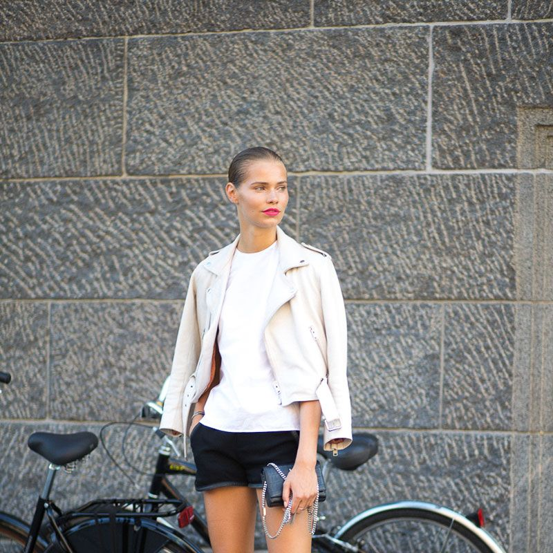 <p>The classic summer model off-duty uniform essentials: a leather jacket, white tee, denim shorts and white sneakers. </p>
