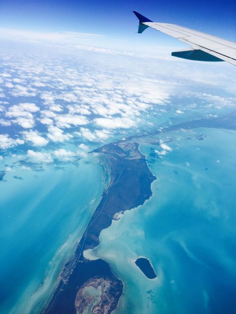 <p>The scenery when flying into Harbour Island is mesmerizing and made me feel like I was in a National Geographic television show. This particular view from above the Abaco Islands left me feeling anything but blue.</p>