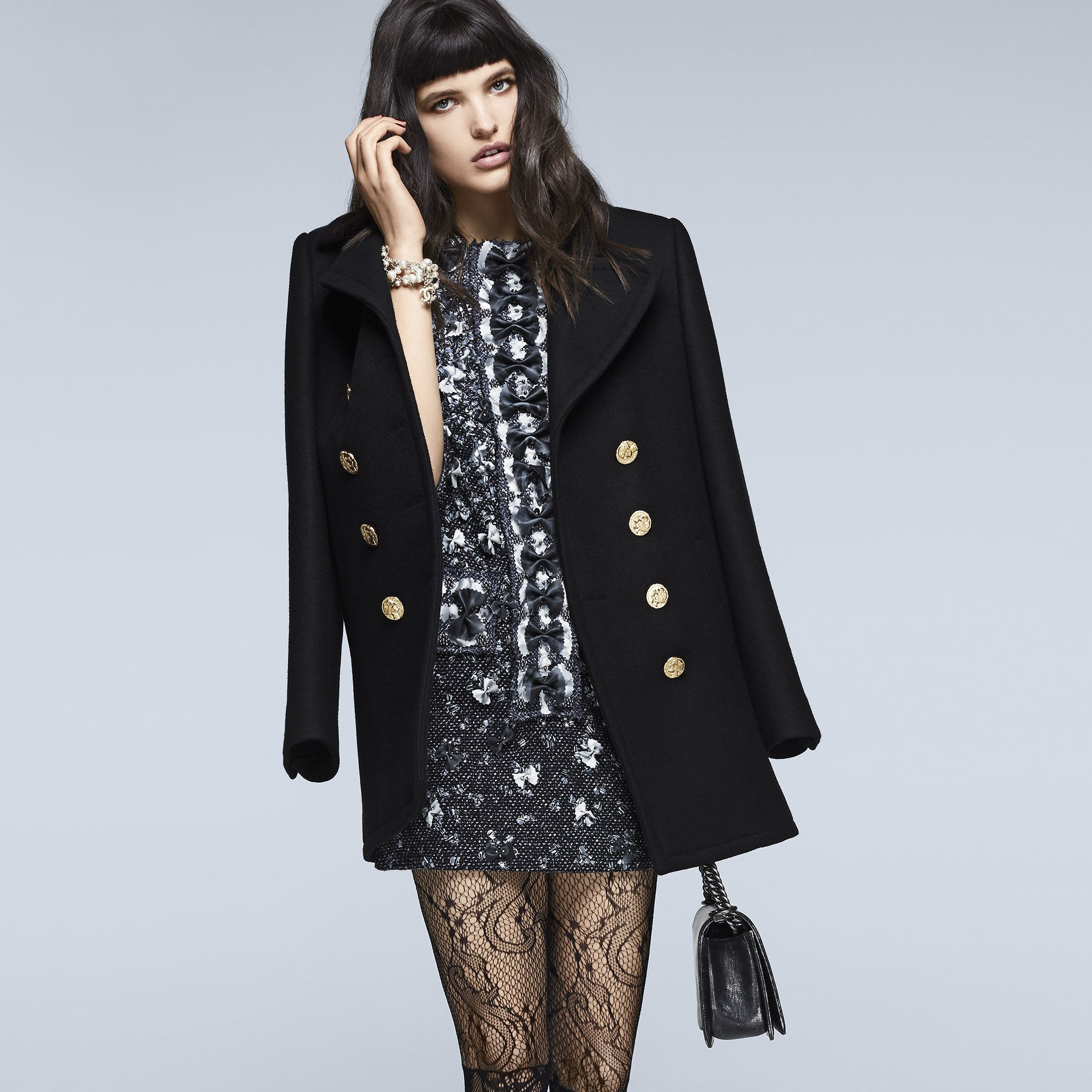 """<p><strong>Chanel </strong>coat, $5,850, tunic, $36,600, necklace (worn as bracelet), $1,475, bag, $7,500, tights, $375, and shoes, $1,100, 800-550-0005.</p><p><strong>BEAUTY BAZAAR: </strong><a href=""""http://www.ulta.com/ulta/browse/productDetail.jsp?productId=xlsImpprod12292013"""" target=""""_blank"""">Rusk Volumizing Mousse</a> delivers instant oomph ($18).</p>"""