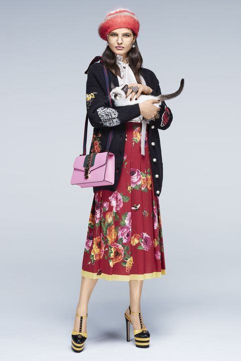 """<p><strong>Gucci </strong>cardigan, $5,980, blouse, $1,390, skirt, $1,890, beret, $360, eyeglasses, price upon request, earrings, $450, rings, $330-$580, bag, $2,490, and shoes, $1,100, <a href=""""https://www.gucci.com/us/en/"""" target=""""_blank"""">gucci.com</a>. </p>"""