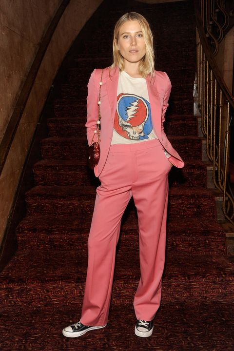 <p>Dree Hemingway balances a feminine pink suit with a hippie tee. </p>