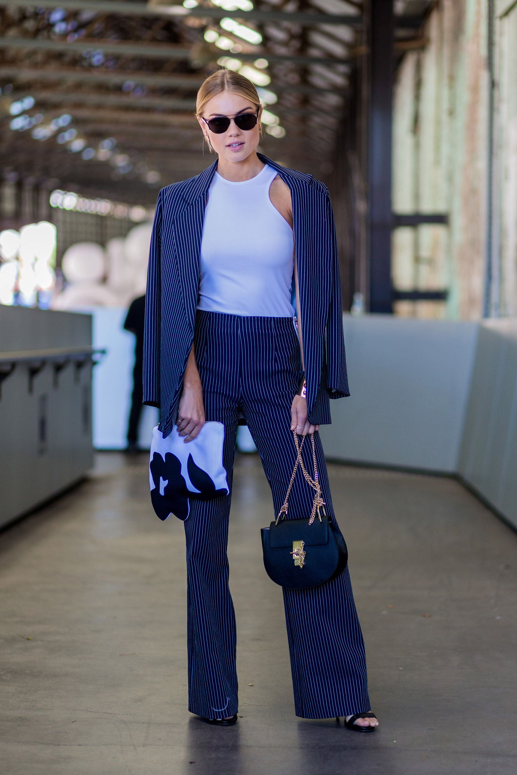 <p>Elyse Knowles' navy pantsuit could read workwear save for a fitted white tank to up the cool girl appeal. </p>