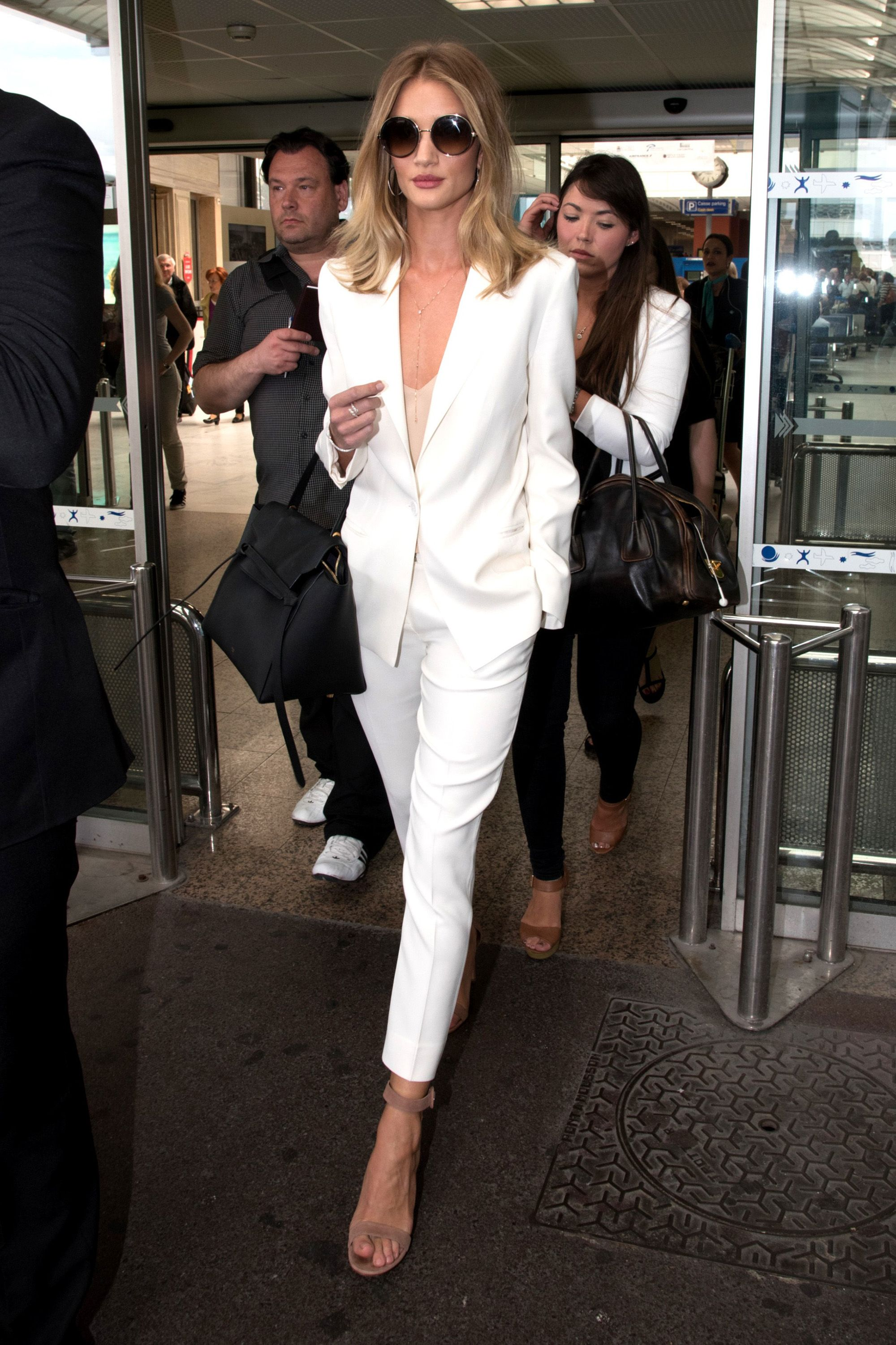 <p>Rosie Huntington-Whiteley's slim white suit by Magda Butrym, paired with neutral sandals, is a star.</p>
