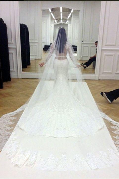 Floor, Flooring, Textile, Door, Wedding dress, Gown, Bridal clothing, Home door, Ivory, Light fixture,