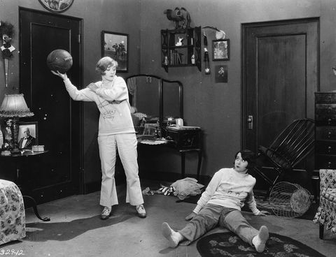 "<p>Dark wood pieces decorate the dorm room of Marion Davies in the movie ""Varsity Girl.""</p>"
